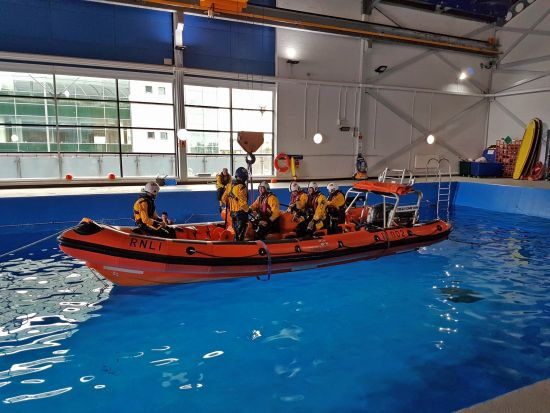 An Atlantic 85 lifeboat about to be capsized in the Sea Survival Pool