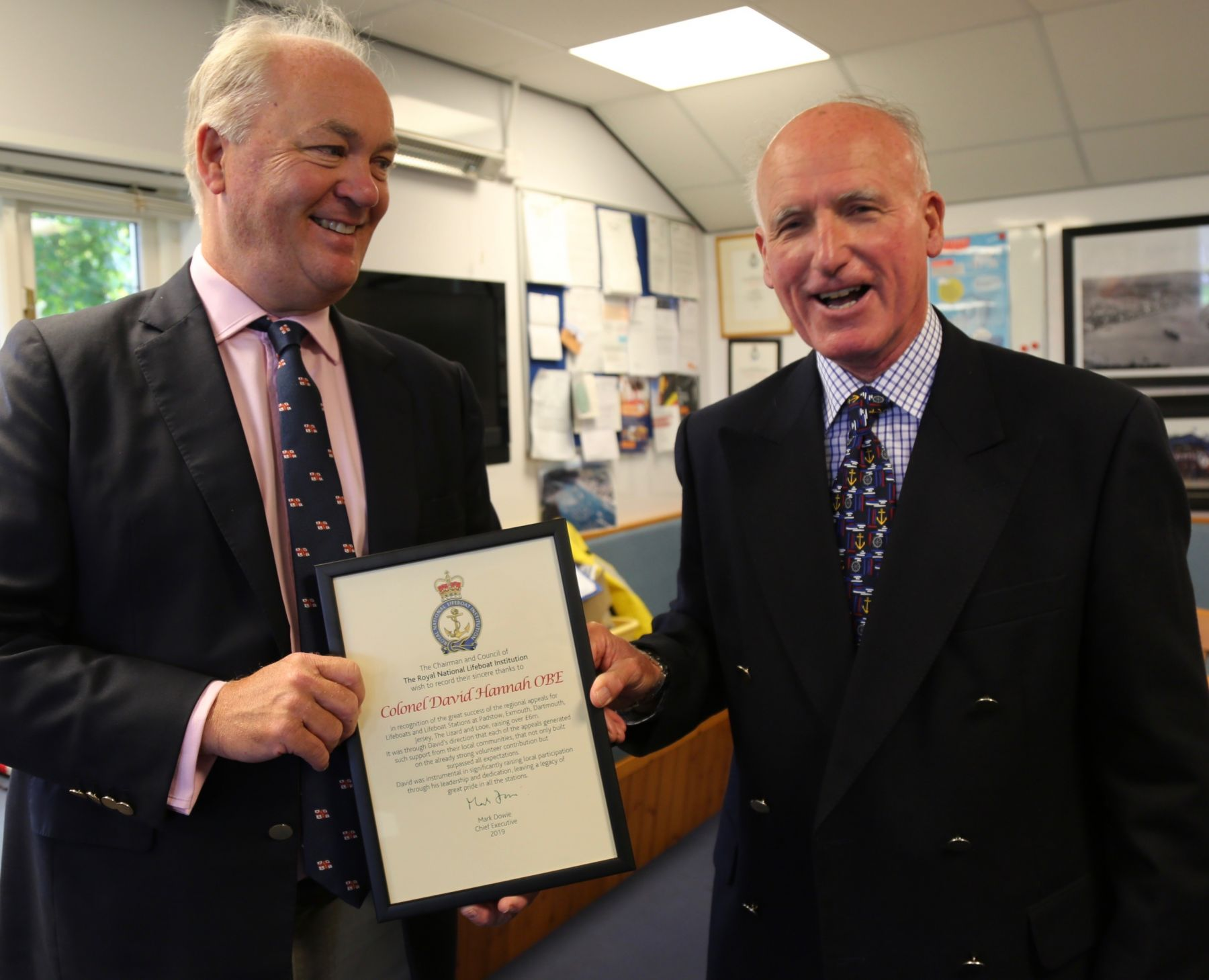 David Hannah being presented with his certificate by Mark Dowie RNLI CEO (Lt)