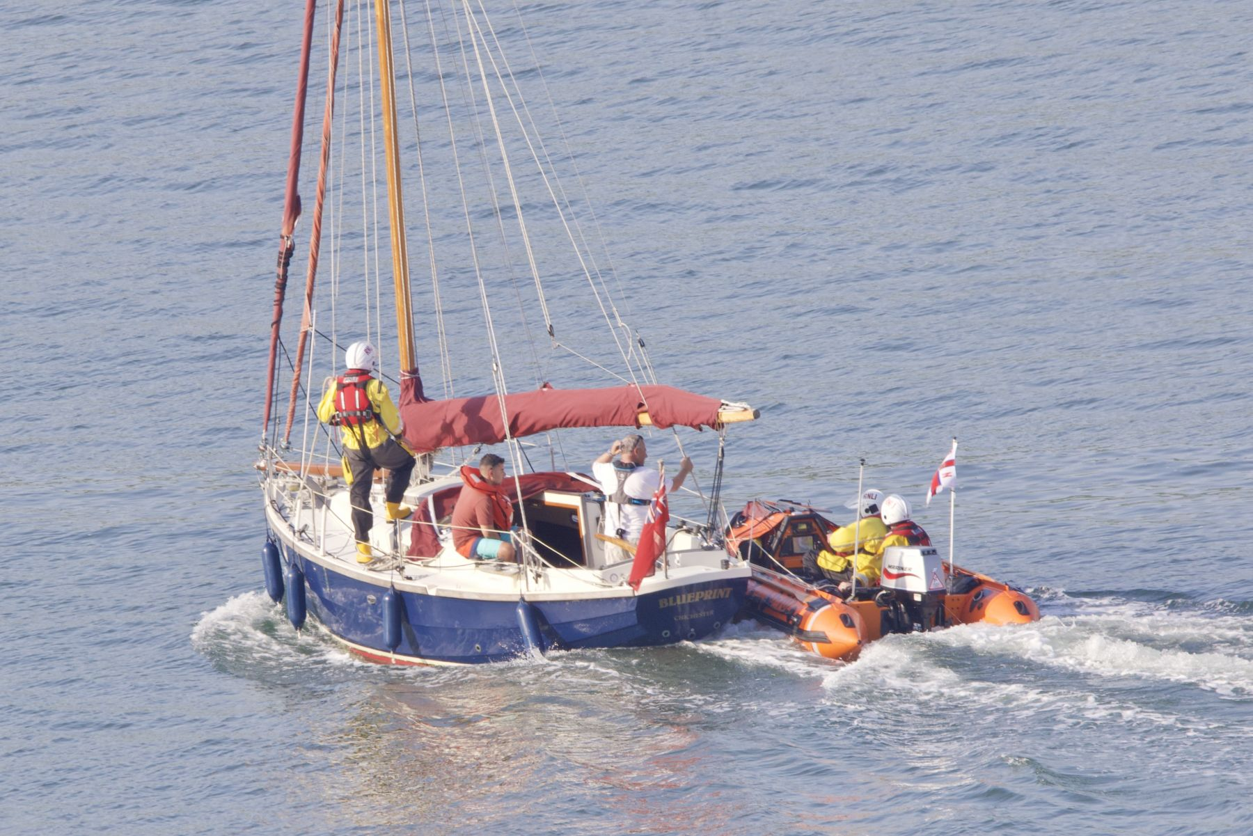 Cornish Crabber under tow in Dartmouth Harbour