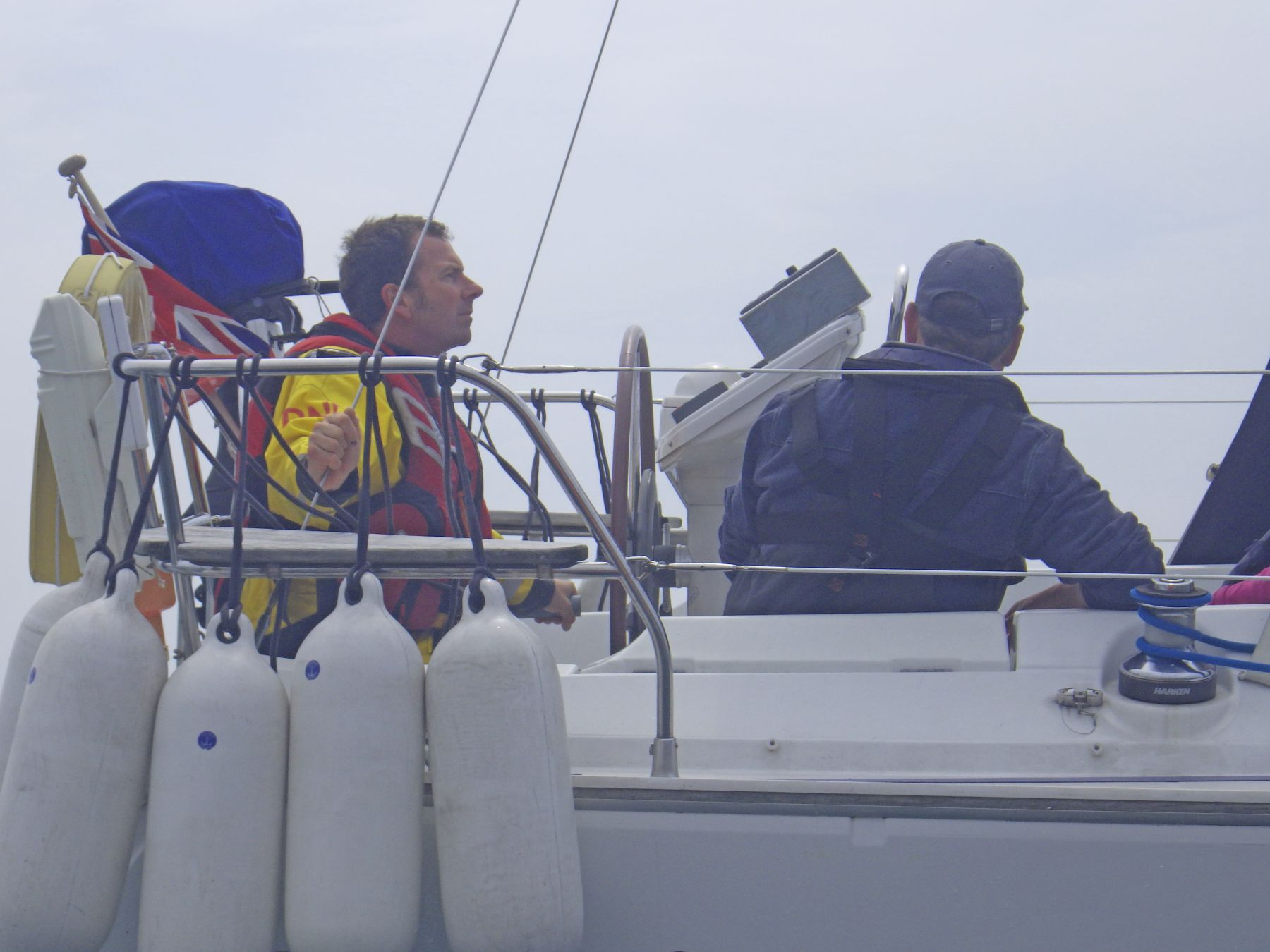 Kevin Murphy using the emergency tiller to sail to Dartmouth.