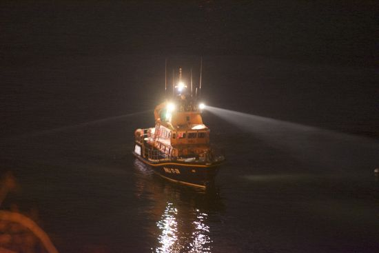 Torbay Lifeboat searching da5rtmouth Harbour for a missing person